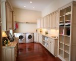 Laundry with cabinets, storage and shelving